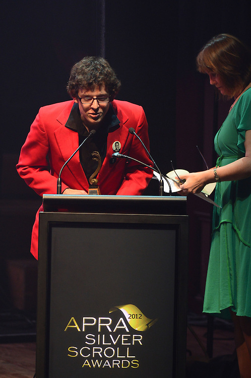 Alex Taylor, winner of the Sounz Contemporary Award, on stage at the APRA Silver Scrolls Awards 2012. Auckland Town Hall. 13 September 2012.