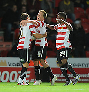Doncaster - Tuesday September 14th, 2010: Doncaster Rovers's James Coppinger is congratulated on scoring his team's first goal during the NPower Championship match at Keepmoat Stadium, Doncaster. (Pic by Dave Howarth/Focus Images)
