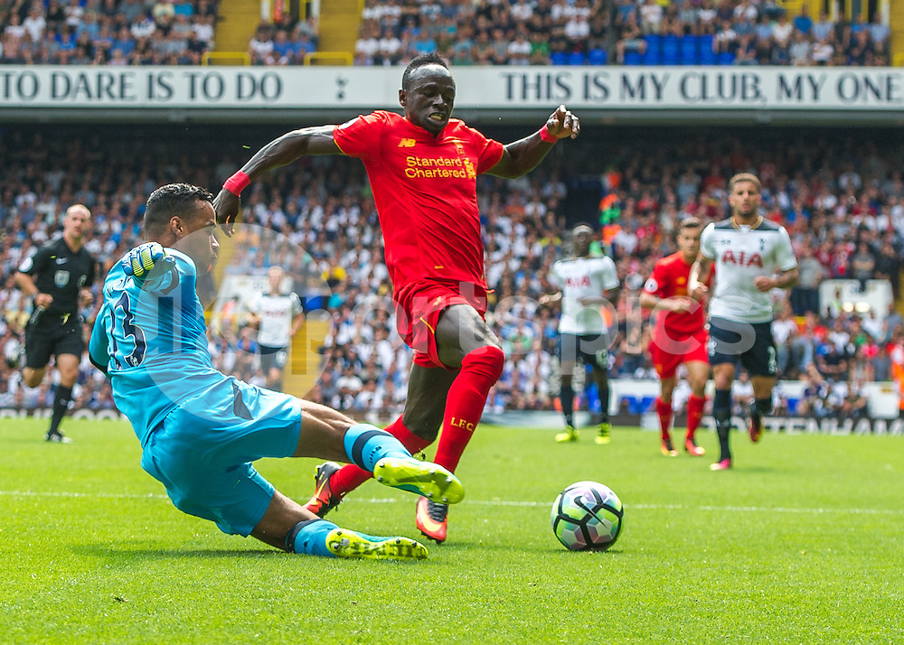 Michel Vorm of Tottenham Hotspur and Sadio Mané of Liverpool during the Premier League match between Tottenham Hotspur and Liverpool at White Hart Lane, London, England on 27 August 2016. Photo by Vince  Mignott.