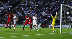 Swansea City's Leroy Fer (left) scores their first goal during the Carabao Cup, Second Round match at Stadium MK, Milton Keynes.