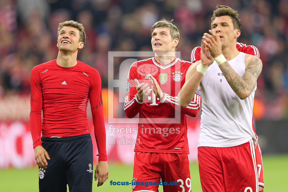 From left to right, Thomas Muller, Toni Kroos and Mario Mandzukic of Bayern Munich celebrate after beating Manchester United 3-1 in the UEFA Champions League match at Allianz Arena, Munich<br /> Picture by Richard Calver/Focus Images Ltd +447792 981244<br /> 09/04/2014