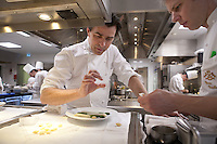 Chef Yannick Alleno of the restaurant le Meurice - three Michelin stars - explaining a detail, with his sous chef