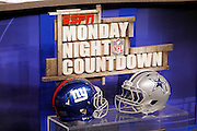The field level television broadcasting set is decorated with the ESPN Monday Night Countdown sign and the helmets of the competing teams prior to the Dallas Cowboys NFL week 7 football game against the New York Giants on Monday, October 25, 2010 in Arlington, Texas. The Giants won the game 41-35. (©Paul Anthony Spinelli)