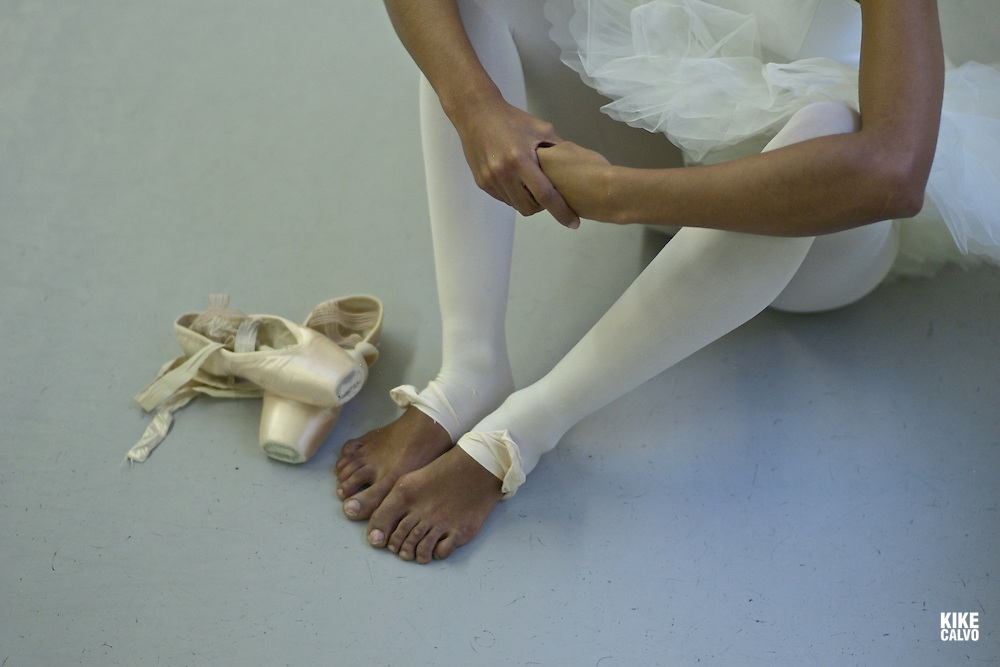 Spanish teen dancer Tayma, 20, has been training at the Maria de Avila Ballet School in Zaragoza since she was a child.Detail of ballerina shoes and damaged feet.
