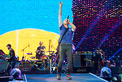 © Licensed to London News Pictures. 15/06/2016.  Coldplay members JONNY BUCKLAND, WILL CHAMPION, CHRIS MARTIN and GUY BERRYMAN play at Wembley Stadium during their Handful of Dreams World tour.<br /> <br /> Please note this supplied photo is for editorial usage only and cannot be used for merchandise.  This supplied photo must be deleted and withdraw from usage on 14th September 2016 as agreed by Coldplay management.  London, UK. Photo credit: Ray Tang/LNP
