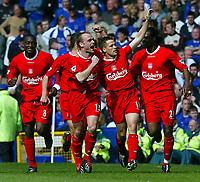 Photo Aidan Ellis.<br />Everton v Liverpool (FA Barclaycard Premiership)<br />19/04/2003.<br />Liverpool's gaol scorers Danny Murphy and Michael Owen celebrate Owen's goal