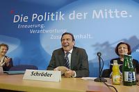 """13 MAY 2002, BERLIN/GERMANY:<br /> Gerhard Schroeder, SPD, Bundeskanzler, unter dem Schriftzug """"Die Politik der Mitte"""", vor Beginn der SPD Parteikonferenz, links: Heidemarie Wieczorek-Zeul, Bundesentwicklungshilfeministerin, Willi-Brandt-Haus<br /> IMAGE: 20020513-03-006<br /> KEYWORDS: Gerhard Schröder"""