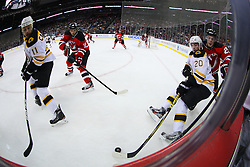 Jan 4, 2012; Newark, NJ, USA; Boston Bruins left wing Daniel Paille (20) and New Jersey Devils defenseman Mark Fayne (29) battle for the loose puck during the first period at the Prudential Center.