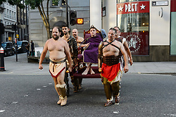 © Licensed to London News Pictures. 25/08/2017. London, UK. Gladiators carry an Roman Emperor on a Sedan chair before fighting it out in an epic battle of swords and shields as part of Londinium, a season of events hosted by the City of London Corporation. The Galdiator Games, staged by the Museum of London, run until Monday. Photo credit: Ray Tang/LNP