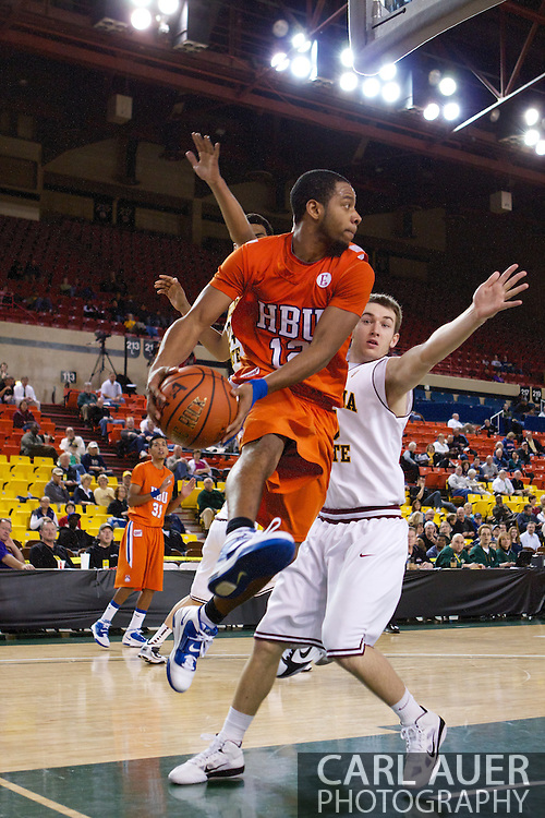 November 25th, 2010:  Anchorage, Alaska - Houston Baptist guard Michael Moss (12) looks for a pass baseline against the Arizona State defense in the Sun Devils 73-55 win over Houston Baptist in their first round game of the Great Alaska Shootout.