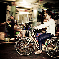 Girl on bike, French Quarter, Hanoi, Vietnam