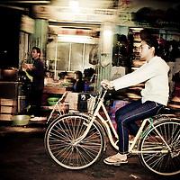 Girl on bike, French Quarter, Hanoi, Vietnam