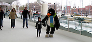 Parker the Penquin (right) during a session with the ice rink's mascot at the RiverScape MetroPark in downtown Dayton, Sunday, January 22, 2012.
