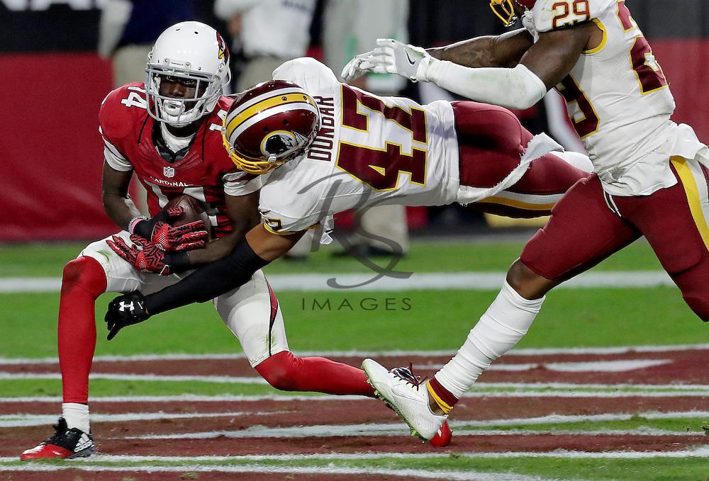 Arizona Cardinals wide receiver J.J. Nelson (14) makes a touchdown catch as Washington Redskins cornerback Quinton Dunbar (47) defends during the second half of an NFL football game, Sunday, Dec. 4, 2016, in Glendale, Ariz. (AP Photo/Rick Scuteri)