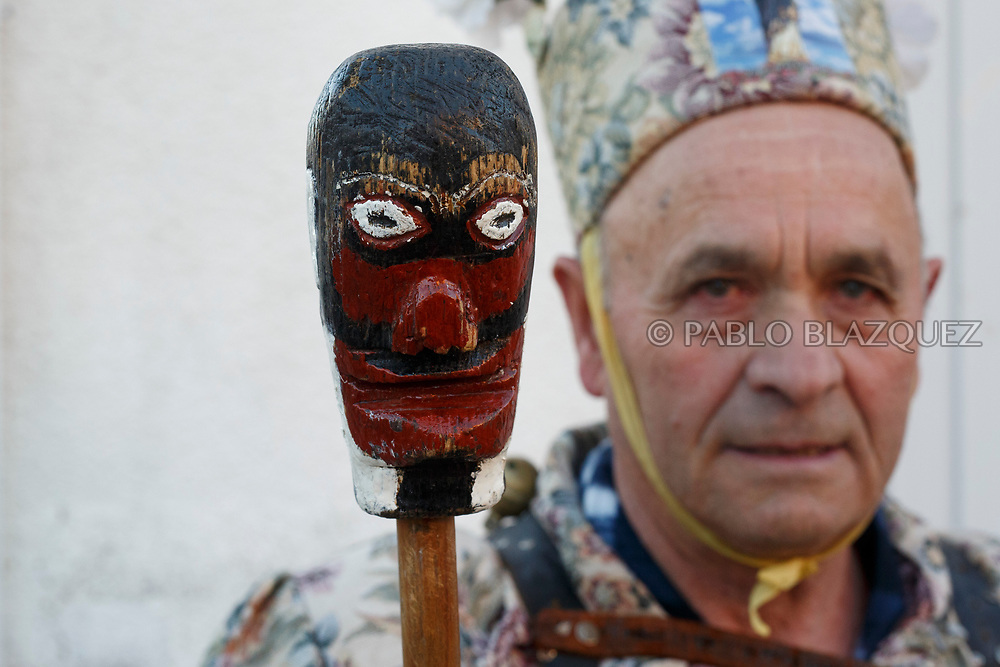 2018/02/02. ALMONACID DEL MARQUESADO, SPAIN - JANUARY 16: Worshipper Julián Carrascosa dressed as Diablo 'Devil' poses with his porra 'baton' during the Endiablada 'The Brotherhood of the Devils' festival on February 2, 2018 in Almonacid del Marquesado, Cuenca province, Spain. La Endiablada is a centenary tradition of unknown origins celebrated on Virgen de la Candelaria 'Our Lady of Candelaria' and San Blas 'Saint Blaise' days. The Diablos wear colourful clothes, a hat and carry bells and personalised porras 'batons'. (Photo by Pablo Blazquez Dominguez)