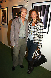 Musician ADAM CLAYTON from U2 and SUSIE SMITH at a party to launch the One T-Shirt by Edun held at Harvey Nichols, Knightsbridge, London on 18th October 2006.<br />