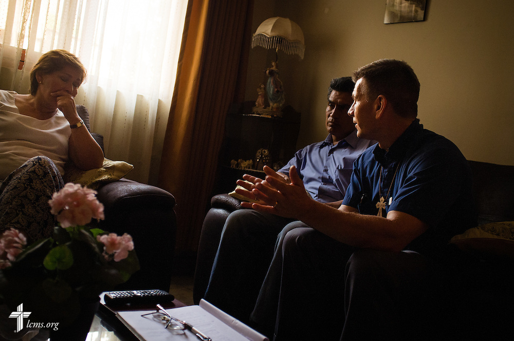 The Rev. Mark Eisold, LCMS career missionary to Peru, visits with a resident on Tuesday, April 7, 2015, on the outskirts of Lima, Peru. LCMS Communications/Erik M. Lunsford