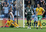 Coventry - Saturday August 9th, 2008: David Marshall, John Kennedy and Dejan Stefanovic of Norwich City, look sick after Leon McKensie of Coventry City scores his teams second during the Coca Cola Championship match at The Ricoh Arena, Coventry. (Pic by Michael Sedgwick/Focus Images)