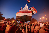 Cairo, Egypt, Dec 01, 2012 - Supporters of the Muslim Brotherhood and Islamist groups hold national flags and placards and even boat replicas with the national colors, during a demonstration in support of President Mohamed Morsi near Cairo University. Saturday's demonstration was organized by the Muslim Brotherhood and held to counter protests against Morsi's recent declaration giving himself almost unlimited powers beyond judicial review. (Photo by Miguel Juárez Lugo)