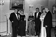 President John F. Kennedy entertained at a dinner party given by President Eamon de Valera at Áras an Uachtarain. Included in the group are An Taoiseach Seán Lemass, Mrs. de Valera and Mrs. Eunice Shriver..26.06.1963