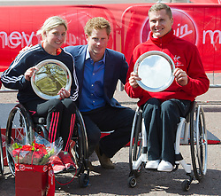 © London News Pictures. 22/04/2012. London, UK. Prince Harry poses with the Men's and Women's Wheelchair Race winners Shelly Woods (L) and David Weir (R) of Great Britain during the 2012 Virgin London Marathon on April 22, 2012 in London, England. Photo credit : Ben Cawthra /LNP
