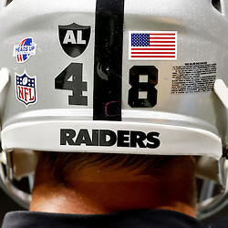Aug 16, 2013; New Orleans, LA, USA; A detail of Oakland Raiders tight end Jeron Mastrud (48) helmet featuring a heads up sticker raising awareness for helmet safety before a preseason game against the New Orleans Saints at the Mercedes-Benz Superdome. Mandatory Credit: Derick E. Hingle-USA TODAY Sports