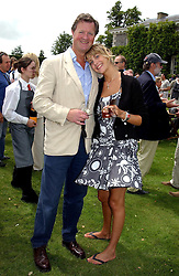 "The EARL OF BALFOUR and his daughter LADY CANDIDA BALFOUR at a luncheon hosted by Cartier at the 2004 Goodwood Festival of Speed on 27th June 2004.  Cartier sponsored the ""Style Et Luxe' for vintage cars on the final day of this annual event at Goodwood House, West Sussex."