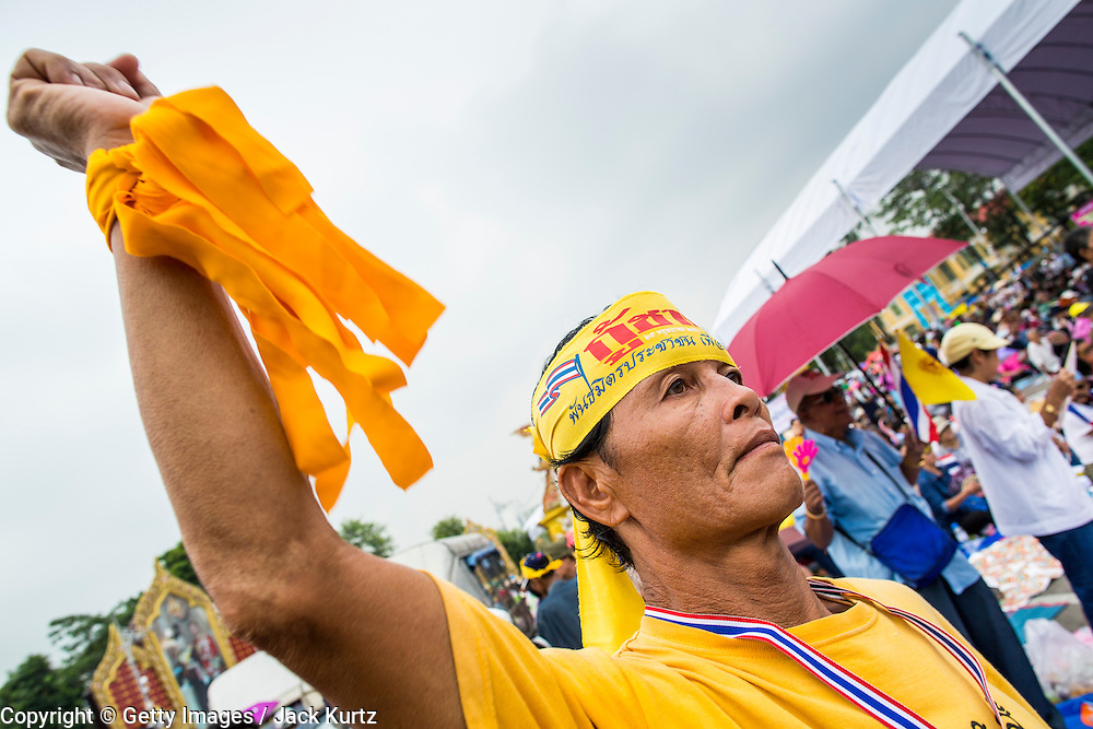 24 NOVEMBER 2012 - BANGKOK, THAILAND: A man cheers for calls to disband the government of Thai Prime Minister Yingluck Shinawatra during a large anti government, pro-monarchy, protest  on November 24, 2012 in Bangkok, Thailand. The Siam Pitak group, which sponsored the protest, cited alleged government corruption and anti-monarchist elements within the ruling party as grounds for the protest. Police used tear gas and baton charges againt protesters.       PHOTO BY JACK KURTZ