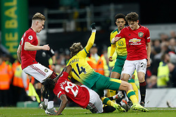Aaron Wan-Bissaka of Manchester United makes a tackle on Todd Cantwell of Norwich City- Mandatory by-line: Phil Chaplin/JMP - 27/10/2019 - FOOTBALL - Carrow Road - Norwich, England - Norwich City v Manchester United - Premier League