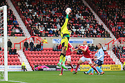 Swindon Town goalkeeper Lawrence Vigouroux tips the ball away from goal during the Sky Bet League 1 match between Swindon Town and Coventry City at the County Ground, Swindon, England on 24 October 2015. Photo by Jemma Phillips.