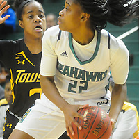 UNCW's Amber Reeves looks to pass around Towson's Breonn Hughey Sunday January 25, 2015 at Trask Coliseum. (Jason A. Frizzelle)