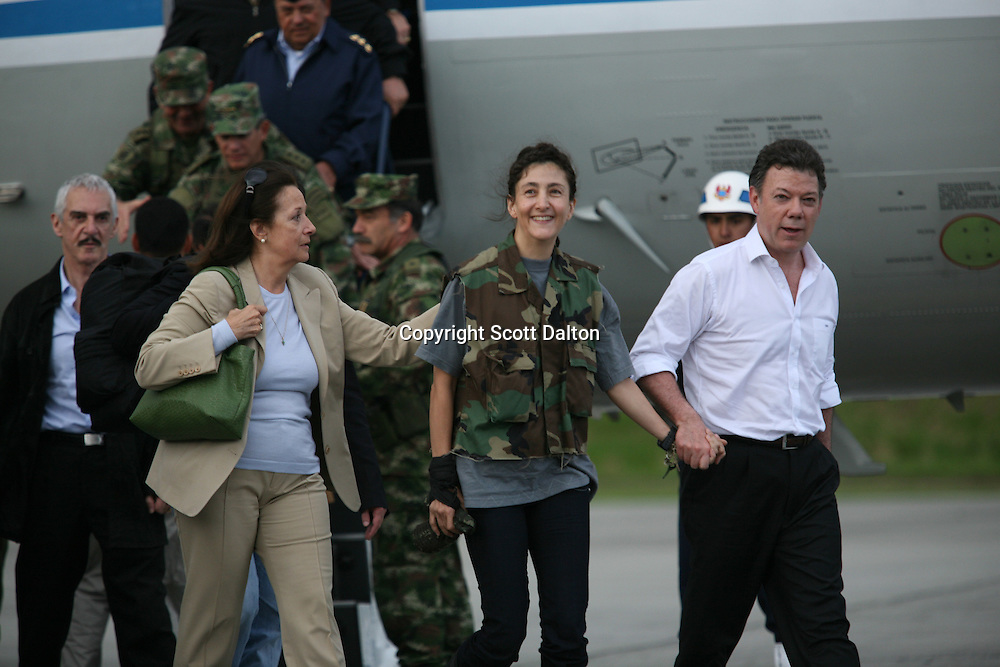 Ingrid Betancourt, who was help captive by FARC rebels for over 6 years, is accompanied by her mother, left, and the Minister of Defense Juan Manuel Santos, right, upon her arrival to Bogotá after being rescued in a Colombian military operation on July 2, 2008. (Photo/Scott Dalton).
