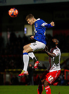 Picture by David Horn/Focus Images Ltd +44 7545 970036<br /> 25/01/2014<br /> John Stones of Everton clears the ball as Francois Zoko of Stevenage looks on during the The FA Cup match at the Lamex Stadium, Stevenage.