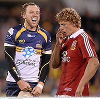 18 June 2013; Jesse Mogg, Brumbies, celebrates alongside a dejected Billy Twelvetrees, British & Irish Lions, at the final whistle. British & Irish Lions Tour 2013, Brumbies v British & Irish Lions. Canberra Stadium, Bruce, Canberra, Australia. Picture credit: Stephen McCarthy / SPORTSFILE