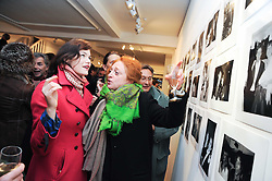 Left to right, JASMINE GUINNESS and CAMILLA LOWTHER at a private view of photographs by Nick Ashley held at the Sladmore Gallery, 32 Bruton Place, London on 13th January 2010.