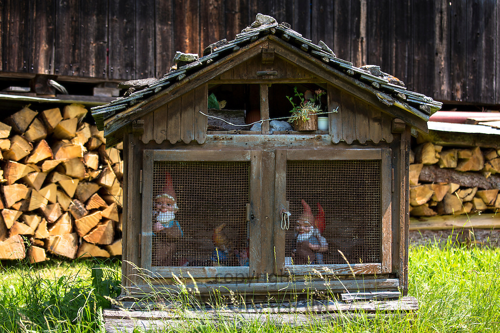 Logpile at typical Swiss wooden chalet and shed of garden gnomes in Klosters, Graubunden region, Switzerland