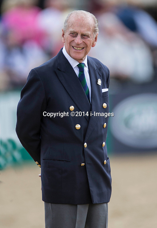 Prince Philip presents the prizes for the Driving for the Disabled class at the Windsor Horse Show today. Windsor Horse Show, Windsor, United Kingdom. Thursday, 15th May 2014. Picture by i-Images