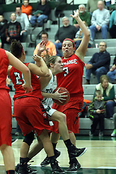 10 January 2015:  Moly McGraw splits defenders Alexis Hahn and Kasey Kleiner during an NCAA women's division 3 CCIW basketball game between the Carthage Reds and the Illinois Wesleyan Titans in Shirk Center, Bloomington IL