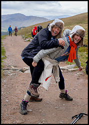 Image ©Licensed to i-Images Picture Agency. 30/05/2015. Fort William, Scotland,United Kingdom. Loose Women Stars. Kaye Adams (R) helps Linda Robson climb up Ben Nevis with Climb with Ed in connection with the charity Children with Cancer. Picture by Andrew Parsons / i-Images