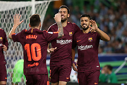 September 27, 2017 - Lisbon, Portugal - Barcelona's Uruguayan forward Luis Suarez (R ) celebrates with Barcelona's Spanish midfielder Sergio Busquets and Barcelona's Argentine forward Lionel Messi after scoring a goal during the UEFA Champions League football match Sporting vs Barcelona at the Alvalade stadium in Lisbon, Portugal on September 27, 2017. Photo: Pedro Fiuza  (Credit Image: © Pedro Fiuza/NurPhoto via ZUMA Press)