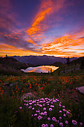 Amazing sunset over Diamond Lake in the Trinity Alps wilderness Four Lakes loop backpacking trail in California.