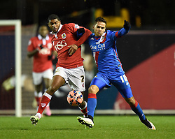 Bristol City's Mark Little and Doncaster's Harry Forrester tussle for the ball in the FA Cup third round replay between Bristol City and Doncaster Rovers at Ashton Gate on January 13, 2015 in Bristol, England.- Photo mandatory by-line: Paul Knight/JMP - Mobile: 07966 386802 - 13/01/2015 - SPORT - Football - Bristol - Ashton Gate Stadium - Bristol City v Doncaster Rovers - FA Cup third round replay