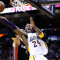 10 March 2011: Los Angeles Lakers shooting guard Kobe Bryant (24) is fouled by Miami Heat center Zydrunas Ilgauskas (11) during the Miami Heat 94-88 victory over the Los Angeles Lakers at the AmericanAirlines Arena, Miami, Florida, USA.