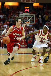 "03 February 2007: Jeremy Crouch makes a cut on Keith ""Boo"" Richardson. In what is locally referred to as the War on Seventy Four, the Bradley Braves defeated the Illinois State University Redbirds 70-62 on Doug Collins Court inside Redbird Arena in Normal Illinois."