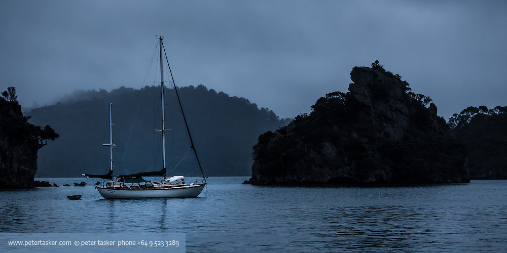 Yacht Ichiban at anchor in Kiwiriki Bay, Port Fitzroy, Great Barrier Island.