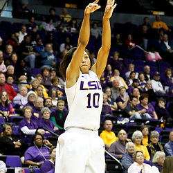 December 13, 2011; Baton Rouge, LA; LSU Lady Tigers guard Adrienne Webb (10) shoots against the UCLA Bruins during the first half of a game at the Pete Maravich Assembly Center.  Mandatory Credit: Derick E. Hingle-US PRESSWIRE