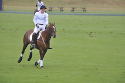 HRH PRINCE HARRY playing polo (White shirt no 2) at the Sentebale Polo Cup held at Coworth Park, Berkshire on 12th June 2011.