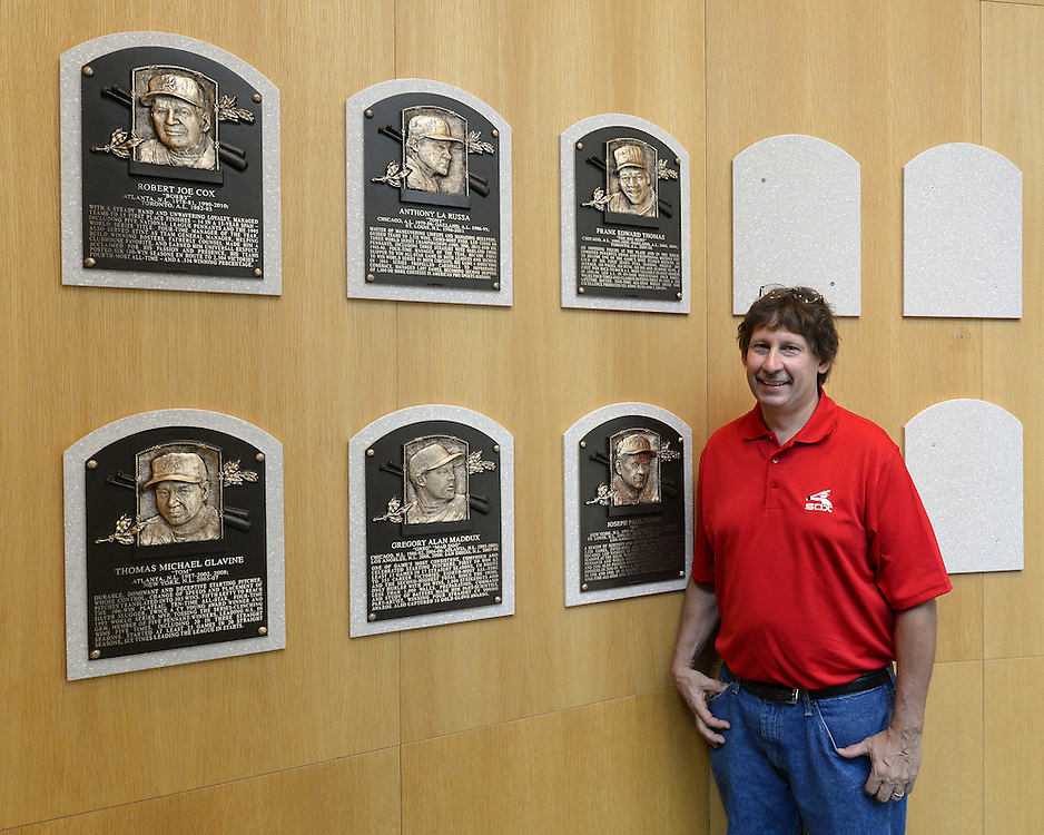 COOPERSTOWN, NY - JULY 28:  Jeff Szynal poses next to the plaque of 2014 Hall of Fame inductee Frank Thomas, on display at the Baseball Hall of Fame and Museum in Cooperstown, New York on July 28 2014.