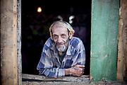 "Portrait of Stephan nicknamed ""Longa"" in his home at the Roma settlement located at ""Budulovska Street"" in Moldava nad Bodvou about 30 km from Kosice. About half a year later the little house of Stephan was empty, he passed away in the end of 2014 by a serious illness."
