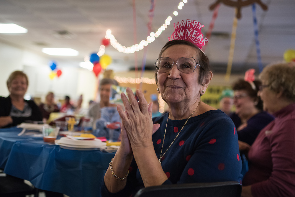 Ellie Chavez of Lyons enjoys the music of Ken Wojcik and his orchestra during a New Year's Eve party at the Howard Mohr Community Center in Forest Park, IL.
